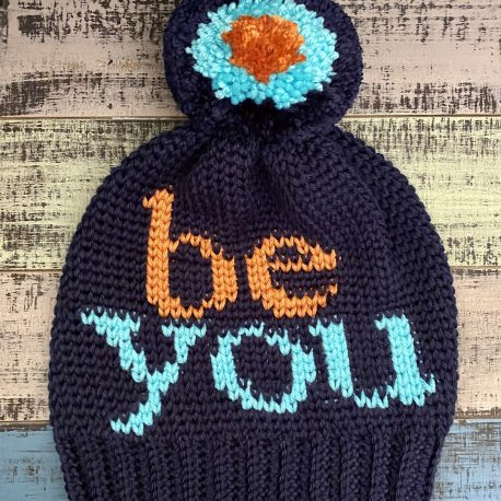 The Be You Beanie is a warm, slouchy beanie with a playful detachable pom pom, inspired by the antibullying campaign Hat Not Hate. I wanted this design to have a message to all who wear it to embrace themselves, find the beauty that they have inside and to just be themselves.